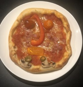 Pizza gezicht smakelijk